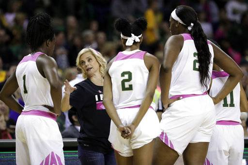FILE - In this Feb. 17, 2018, file photo, Baylor's Dekeiya Cohen (1), Didi Richards (2), Kalani Brown (21) and Alexis Morris (11) listen as head coach Kim Mulkey, second from left, instructs them during a time out in the second half of an NCAA college basketball game against Kansas, in Waco, Texas. While so much is the same as usual in March for the Lady Bears, this has been the most heart-wrenching season off the court for coach Kim Mulkey. (AP Photo/Tony Gutierrez, File)