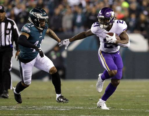 File-This Jan. 21, 2018, file photo shows Minnesota Vikings' Jerick McKinnon running past Philadelphia Eagles' Ronald Darby during the first half of the NFL football NFC championship game in Philadelphia. The 49ers agreed to a four-year contract with versatile running back McKinnon and a five-year deal with interior offensive lineman Weston Richburg on Wednesday, March 14, 2018 just after the start of the new league year. McKinnon will replace starter Carlos Hyde, who was allowed to leave in free agency.(AP Photo/Matt Slocum, File)