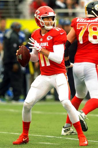 File-This jan. 28, 2018, file photo shows AFC quarterback Alex Smith (11), of the Kansas City Chiefs, looking to pass, during the first half of the NFL Pro Bowl football game against the NFC, in Orlando, Fla. The Alex Smith era has begun in Washington as the Redskins completed their trade for the veteran quarterback. Smith joined the Redskins from the Kansas City Chiefs in exchange for a third-round pick and cornerback Kendall Fuller. The deal and Smith's subsequent four-year contract extension were agreed to in February but couldn't become official until 4 p.m. EDT Wednesday, March 14, 2018, the start of the new league year. (AP Photo/Steve Nesius, File)