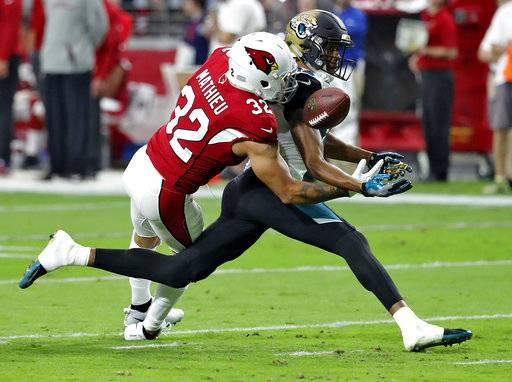 FILE - In this Nov. 26, 2017, file photo, Jacksonville Jaguars wide receiver Keelan Cole (84) can't make the catch as Arizona Cardinals free safety Tyrann Mathieu defends during the first half of an NFL football game, in Glendale, Ariz. The Cardinals have released Mathieu, on Wednesday, March 14, 2018, after the two sides couldn't rework his contract. Mathieu was due for $18.75 million of his contract to be guaranteed when the league year officially begins at 4 p.m. ET. (AP Photo/Rick Scuteri, File)