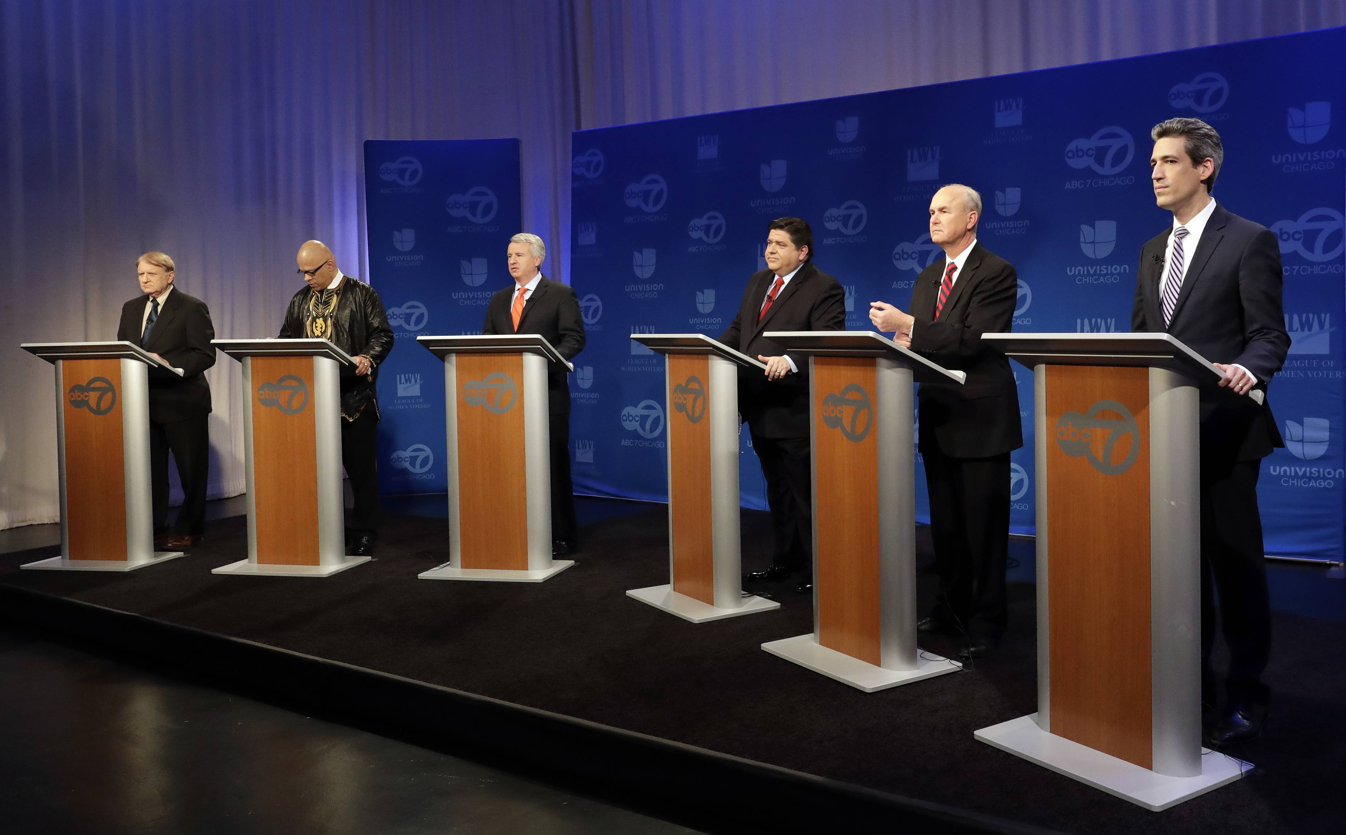 Democratic gubernatorial candidates, left to right, Robert Marshall, Tio Hardiman, Chris Kennedy, J.B. Pritzker, Bob Daiber, and Illinois Sen. Daniel Biss participate in a debate March 2 in Chicago. The nominee will face either Republican Gov. Bruce Rauner or his conservative challenger, State Rep. Jeanne Ives, in November.
