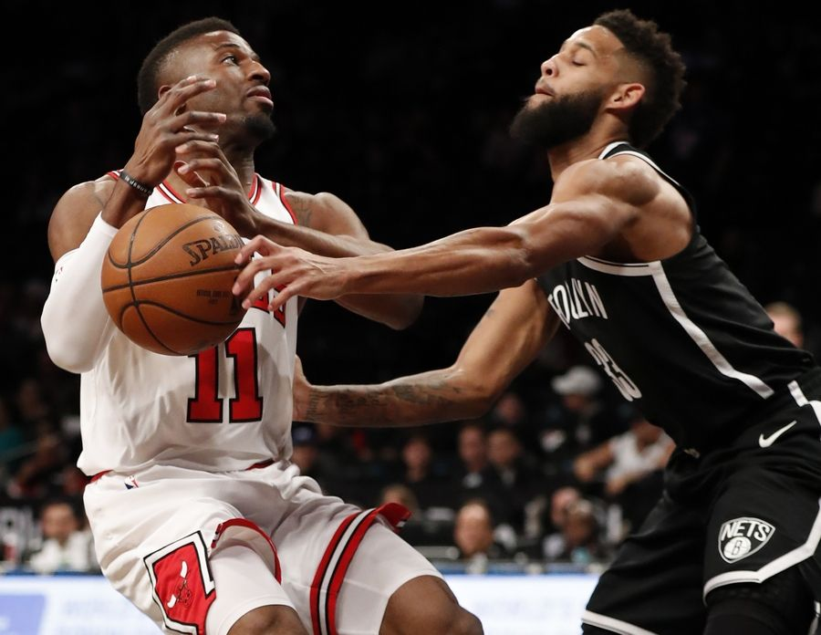 Chicago Bulls forward David Nwaba (11) loses the ball as Brooklyn Nets guard Allen Crabbe (33) forces a turnover during the first half of an NBA basketball game, Monday, April 9, 2018, in New York.