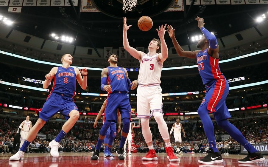 Chicago Bulls center Omer Asik (3) reaches for the rebound from Detroit Pistons forward Henry Ellenson (8), forward Eric Moreland (24) and forward James Ennis III (33) during the first half of an NBA basketball game in Chicago, Wednesday, April 11, 2018.