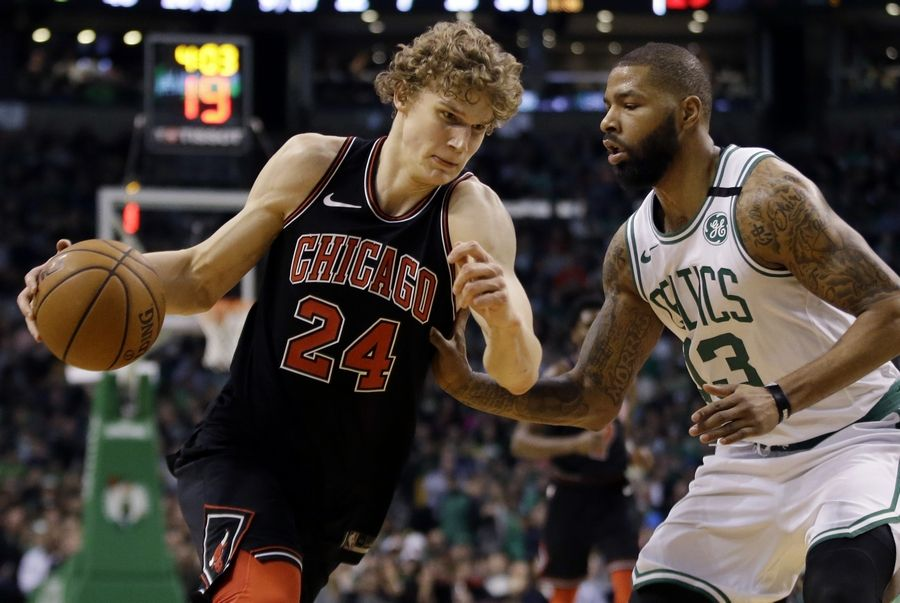 Chicago Bulls forward Lauri Markkanen (24) drives against Boston Celtics forward Marcus Morris (13) in the second half of an NBA basketball game, Friday, April 6, 2018, in Boston.