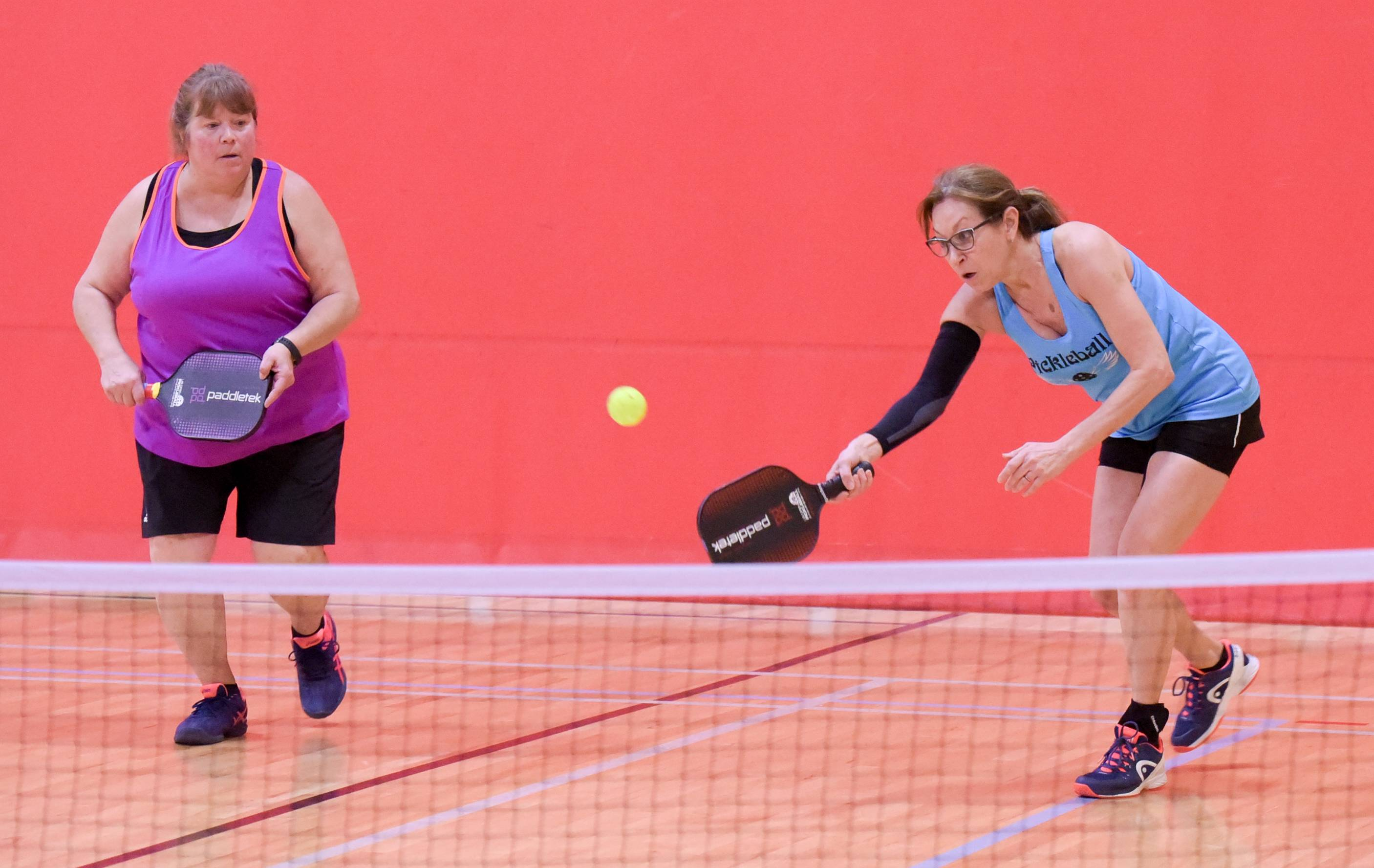 "The ""Dink for Hope"" pickleball tournament organizers Dana Joseph of Palatine and Thea Froehling of Arlington Heights play a match at the Wheeling Community Recreation Center on Sunday."