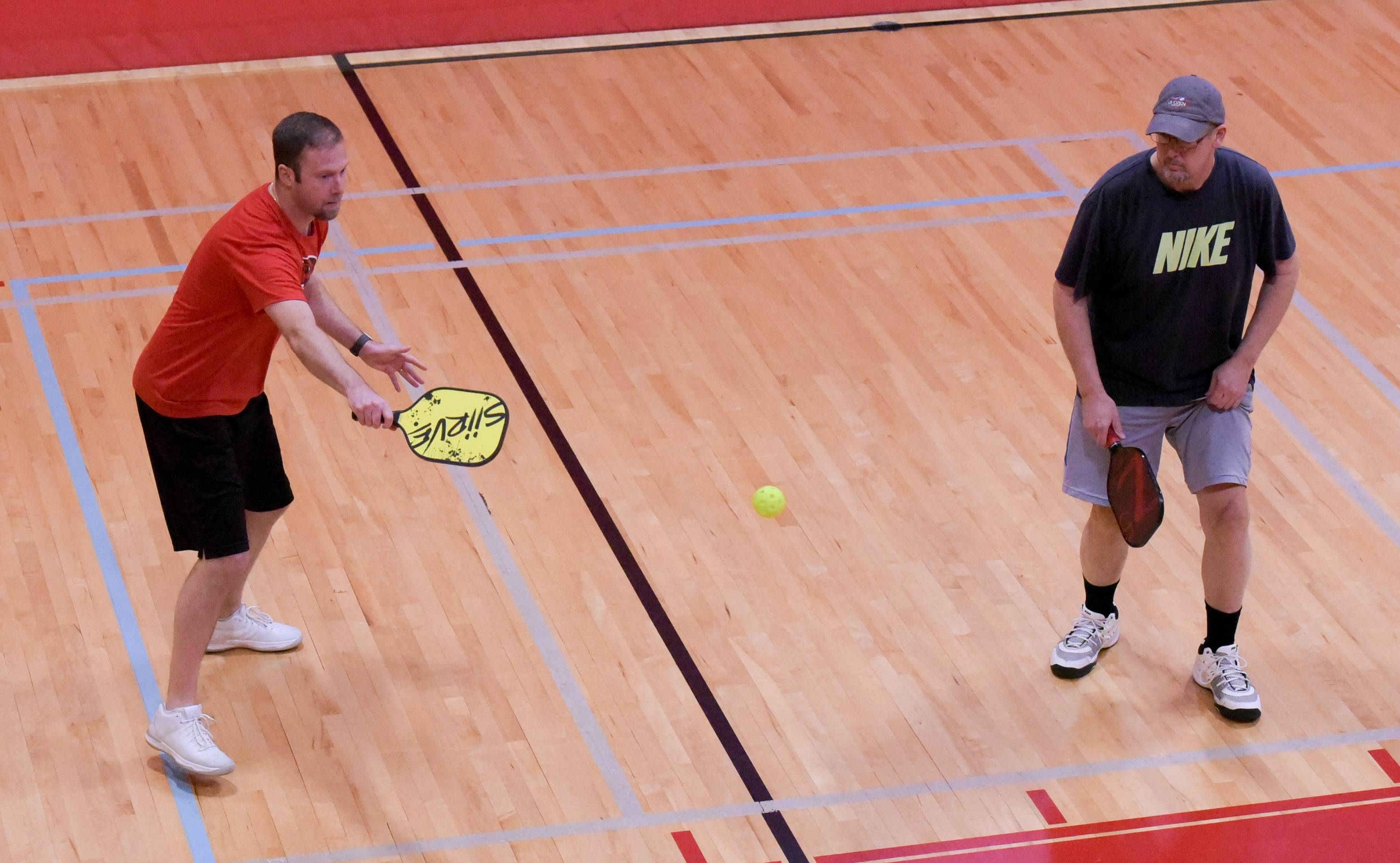 "Ryan Gold of Shorewood and Al Davenport of New Lenox play a match Sunday during the ""Dink for Hope"" pickleball tournament at the Wheeling Community Recreation Center."