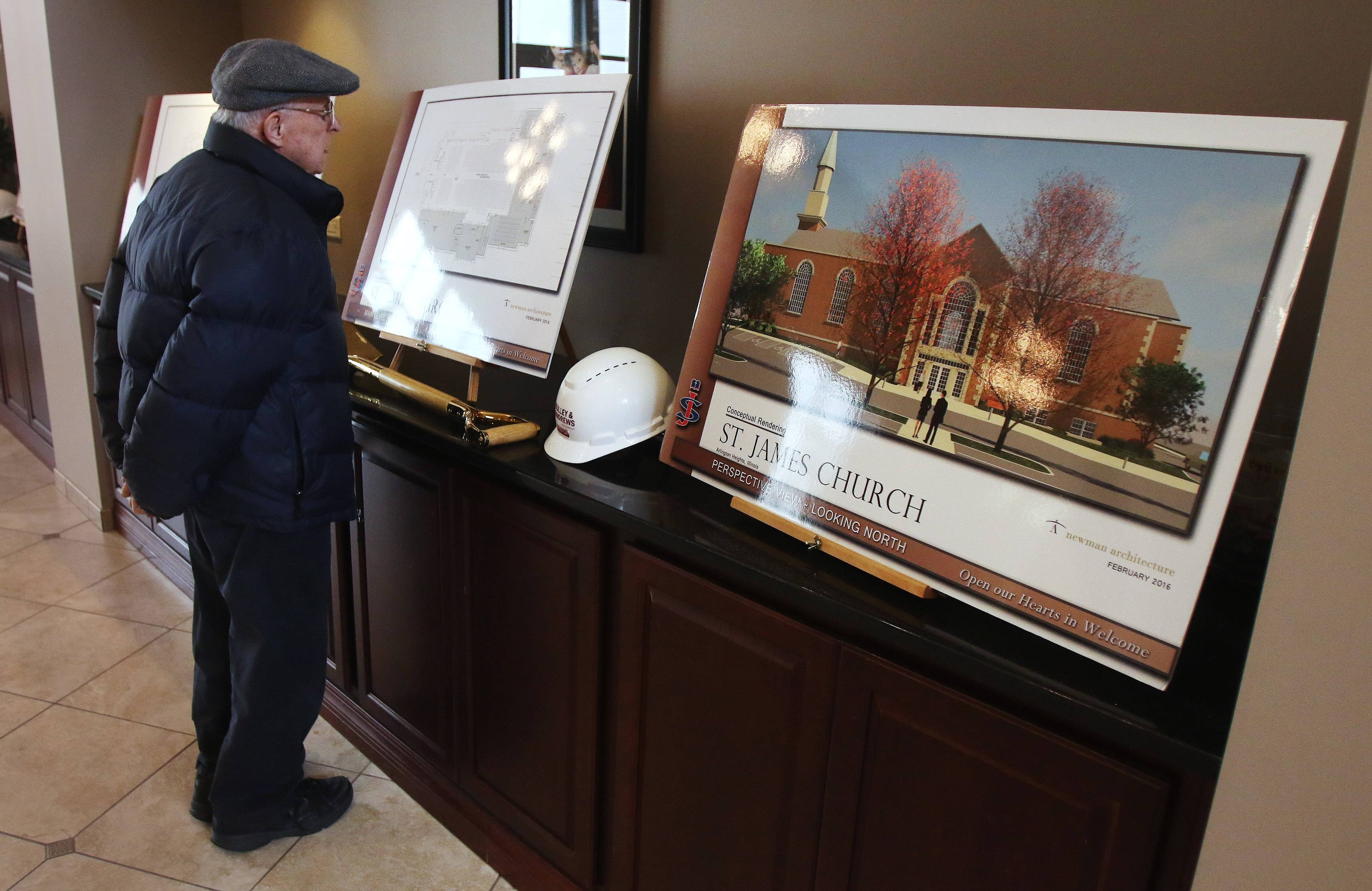 Arlington Heights resident Stan Szott looks at posters illustrating the expansion project that officially got underway Sunday at St. James Catholic Church in Arlington Heights.