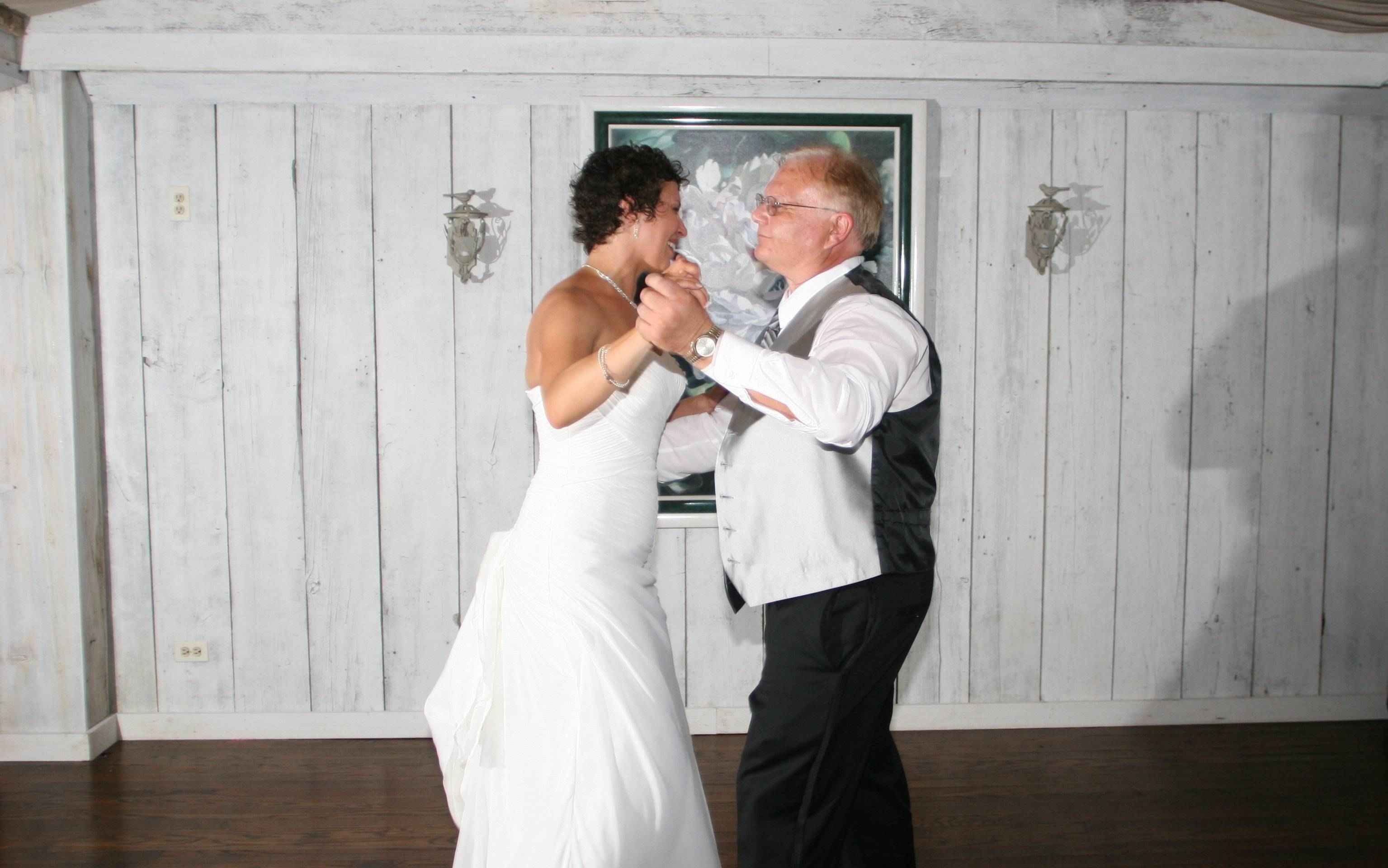 Joe Such of Elk Grove Village dances with new daughter-in-law Kristen at her wedding to Joe's son Danny in 2011.