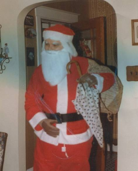 Joe Such, playing Santa on a rainy Christmas in 1983.