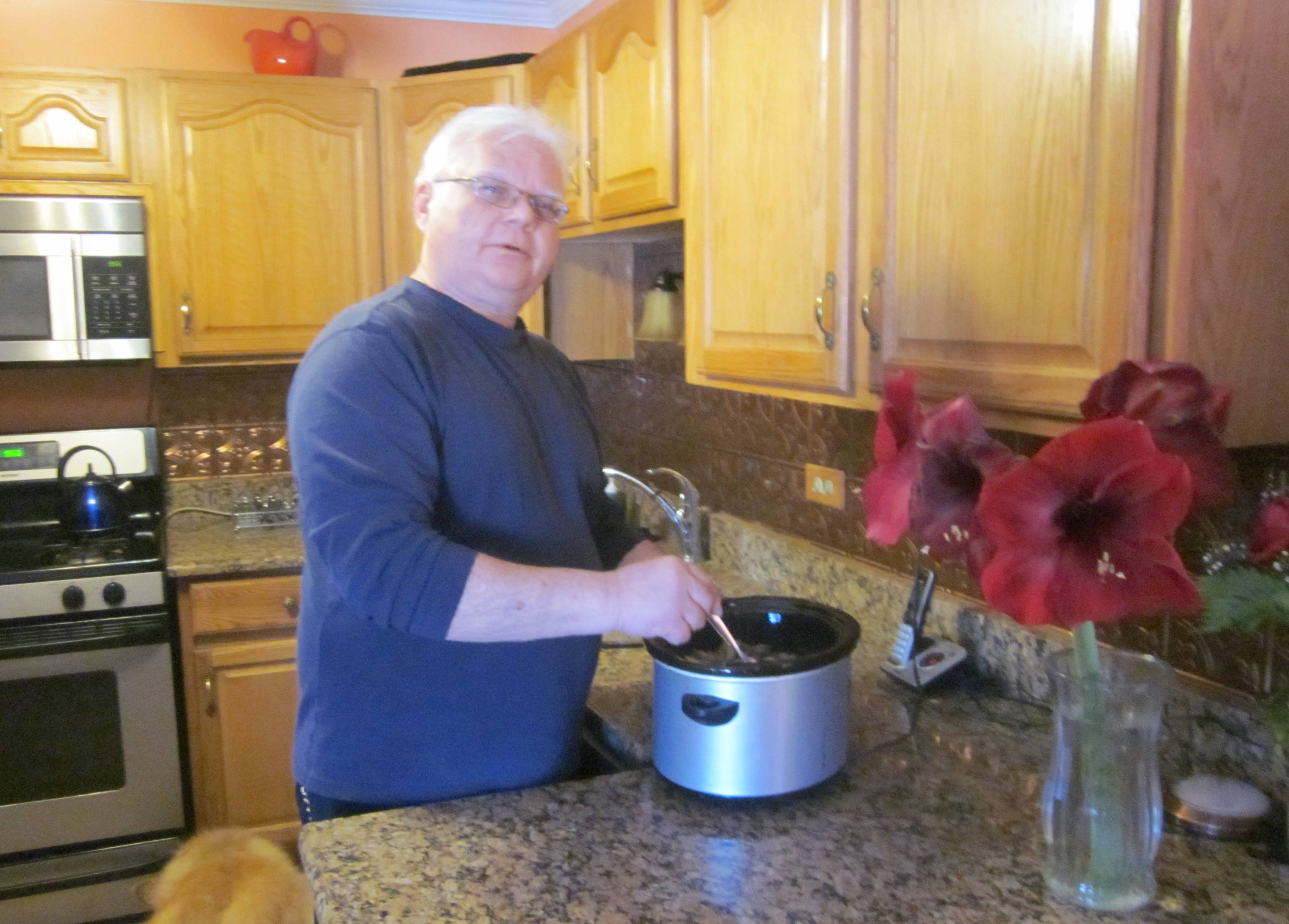 Joe Such indulges in his love of cooking in his Elk Grove Village kitchen in 2014