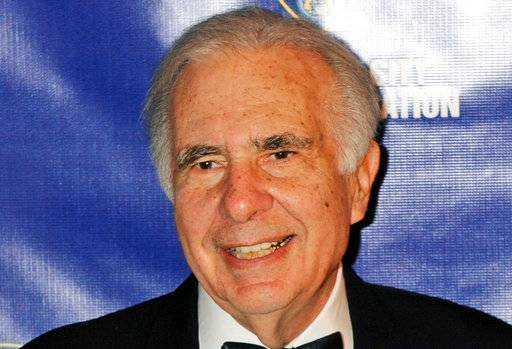 FILE - In this March 16, 2010, file photo, financier Carl Icahn poses for photos upon arriving for the annual New York City Police Foundation Gala in New York. Icahn's company has struck an approximately $1.85 billion deal that would fuse the gaming and hotel operations of Tropicana Entertainment to Eldorado Resorts Inc.
