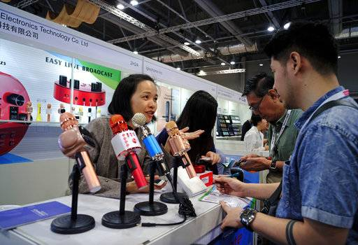In this April 11, 2018 photo, Karaoke microphones are displayed at the Global Sources trade fair, a trade fair where Chinese manufacturers meet western buyers in Hong Kong. Chinese exporters of goods from electronics to motorcycle parts are scrambling to insulate themselves from U.S. President Donald Trump's proposed tariff hike.