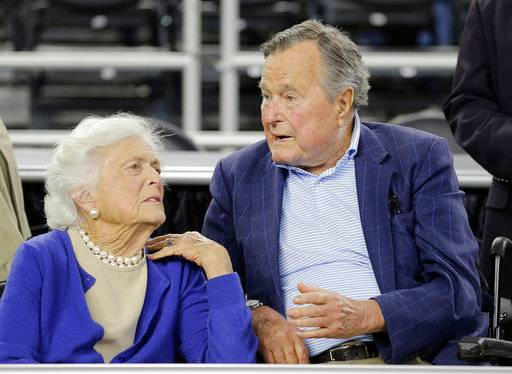 "FILE - In this March 29, 2015, file photo, former President George H.W. Bush and his wife Barbara Bush, left, speak before a college basketball regional final game between Gonzaga and Duke, in the NCAA basketball tournament in Houston. A family spokesman said Sunday, April 15, 2018, that the former first lady Barbara Bush is in ""failing health"" and won't seek additional medical treatment."