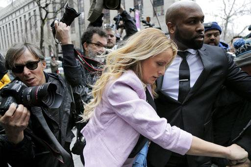 Stormy Daniels arrives at federal court in New York, Monday, April 16, 2018, to attend a court hearing where a federal judge is considering how to review materials that the FBI seized from President Donald Trump's personal lawyer to determine whether they should be protected by attorney-client privilege.