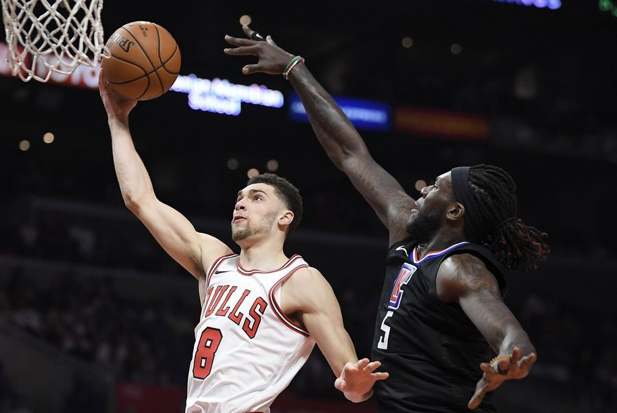 Chicago Bulls guard Zach LaVine, left, shoots as Los Angeles Clippers forward Montrezl Harrell defends during the second half of an NBA basketball game, Saturday, Feb. 3, 2018, in Los Angeles. The Clippers won 113-103.