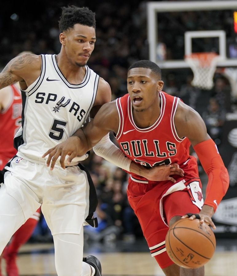 Chicago Bulls guard Kris Dunn, right, drives against San Antonio Spurs guard Dejounte Murray during the first half of an NBA basketball game, Saturday, Nov. 11, 2017, in San Antonio.