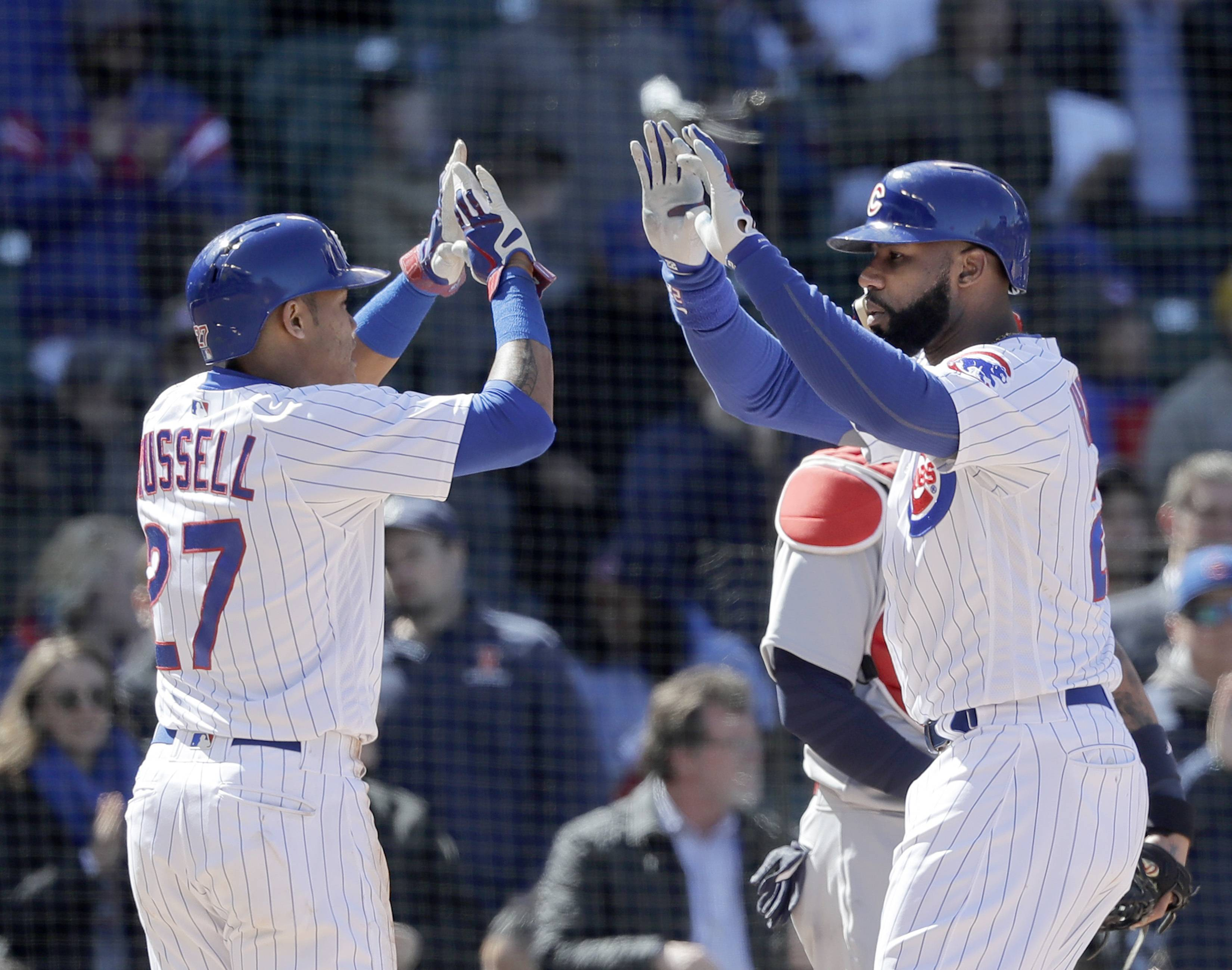 Cubs bats warm up with weather in 8-5 win over Cards