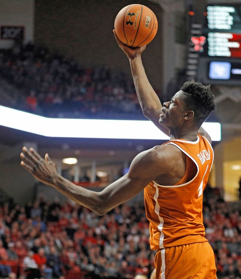Texas' Mo Bamba (4) lays up the ball during the second half of the team's NCAA college basketball game against Texas Tech, Wednesday, Jan. 31, 2018, in Lubbock, Texas.