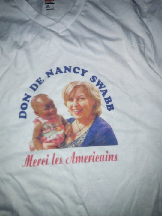 In gratitude to host mom Nancy Swabb and the American team that got their baby a life-altering surgery, a family in Côte d'Ivoire made this T-shirt showing baby Dominique and Swabb.