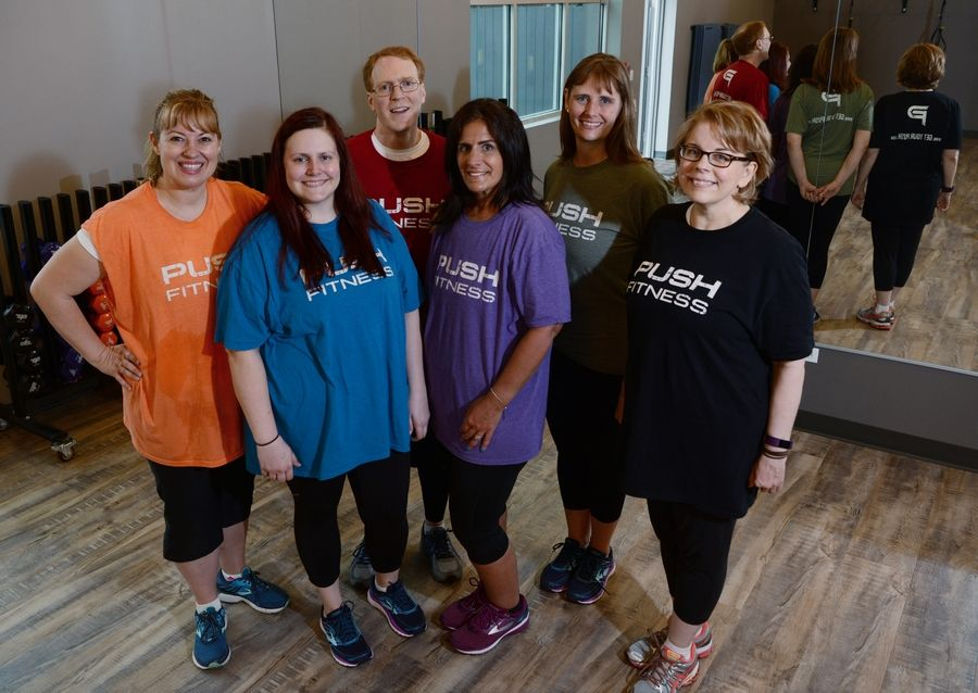 Fittest Loser contestants, from left, Shelley Daley of Arlington Heights, Kimberly Rosewell of Roselle, Chad Lowry of Mount Prospect, Nicole Mueller of Schaumburg and Kristen Binder of Schaumburg, as well as Daily Herald columnist Melynda Findlay at their last workout at Push Fitness in Schaumburg.