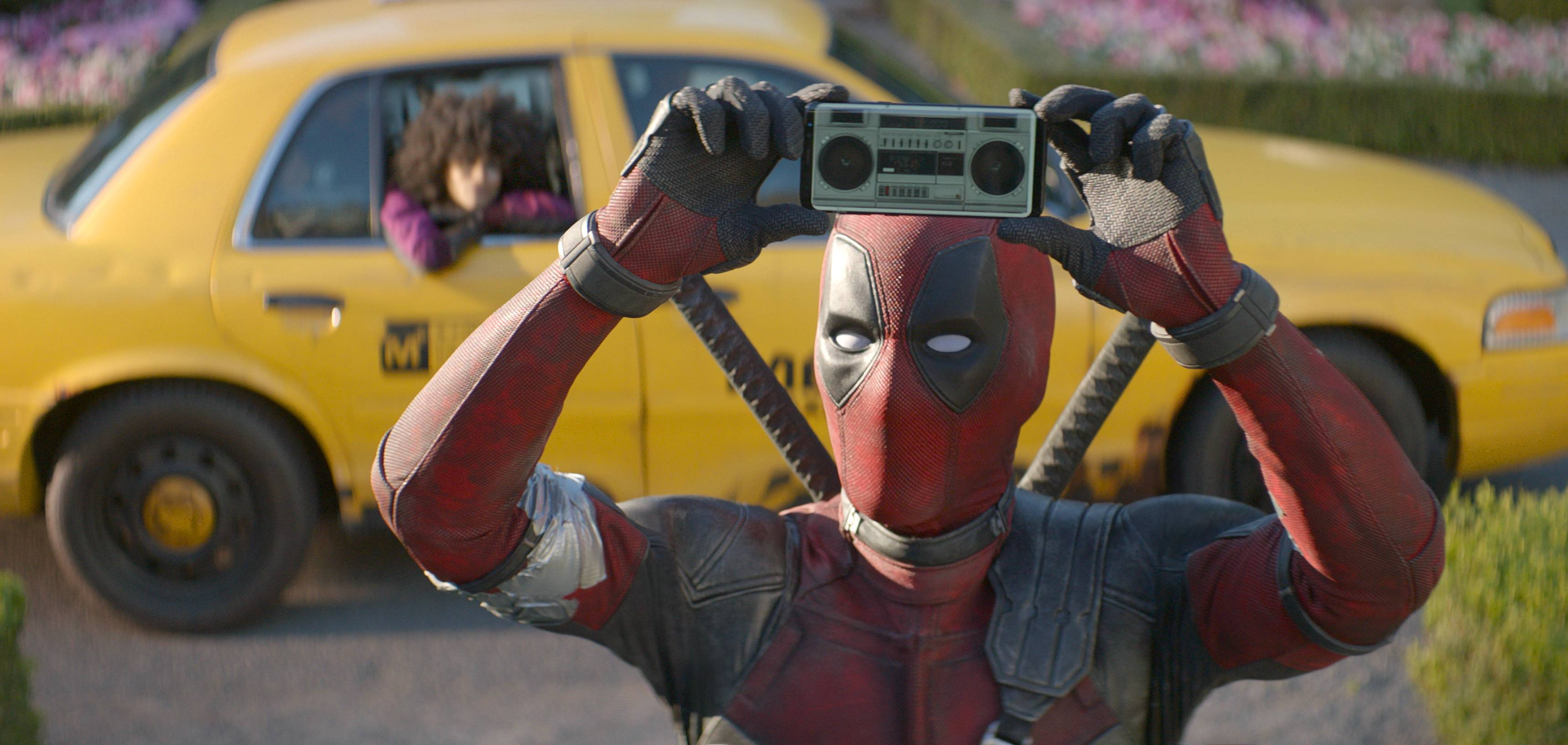 "Ryan Reynolds sends up celebrities, movies and even himself in ""Deadpool 2."""