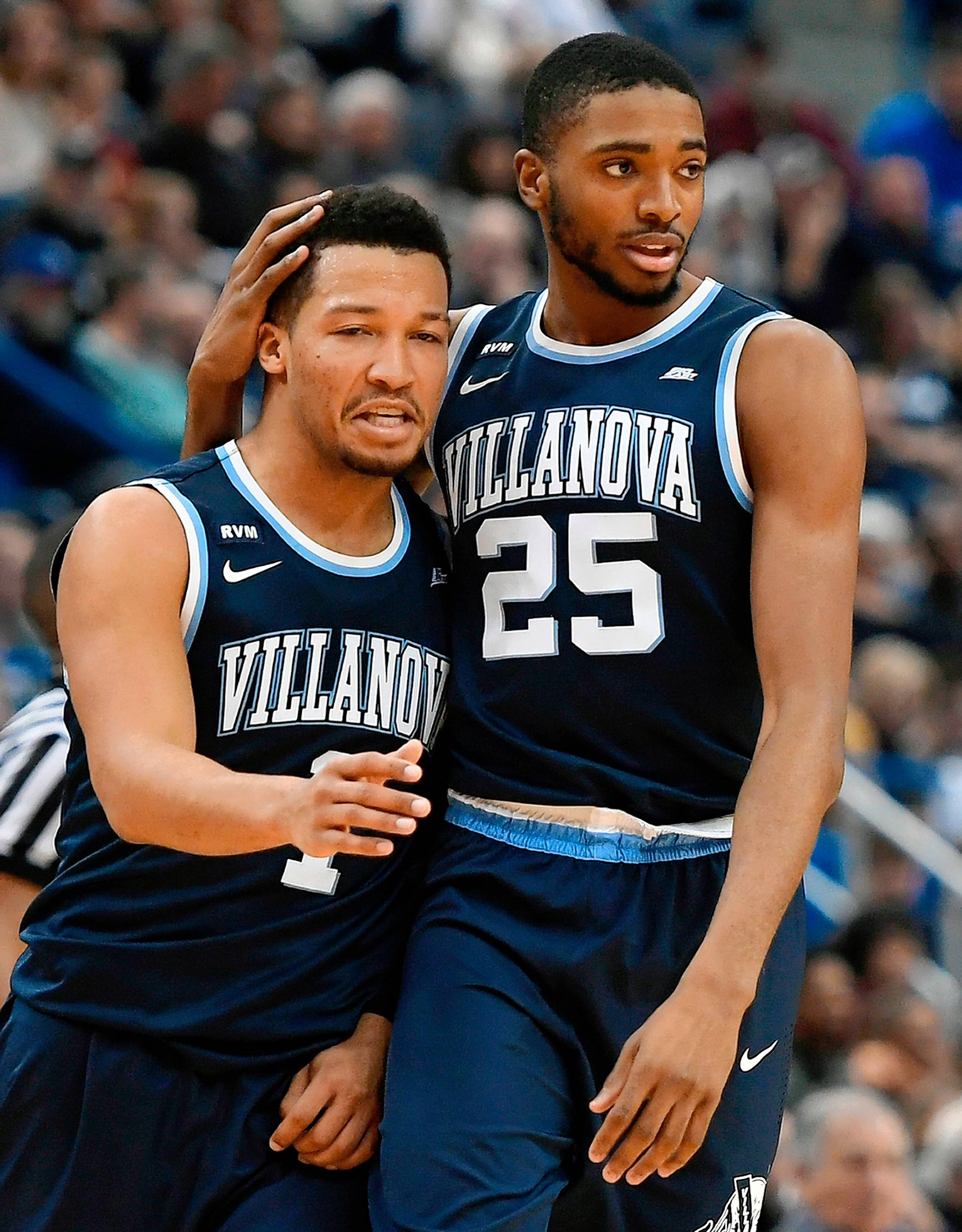 Villanova's Jalen Brunson, a native of Lincolnshire, is embraced by teammate Mikal Bridges during a game last season. Both are projected to be selected in the first round of the NBA draft.