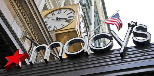 FILE- This May 2, 2017, file photo shows corporate signage at Macy's flagship store in Manhattan, in New York. Macy's Inc. reports earnings Wednesday, May 16, 2018.