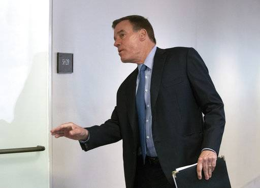 "Senate Intelligence Committee Vice Chairman Mark Warner, D-Va., goes behind closed doors as members of the Senate Intelligence Committee arrive to vote on Gina Haspel, President Donald Trump's pick to lead the Central Intelligence Agency, on Capitol Hill in Washington, Wednesday, May 16, 2018. In announcing his support for the nominee, Warner said Haspel has been ""professional and forthright"" with the intelligence committee, ""Most importantly, I believe she is someone who can and will stand up to the president if ordered to do something illegal or immoral - like a return to torture."""