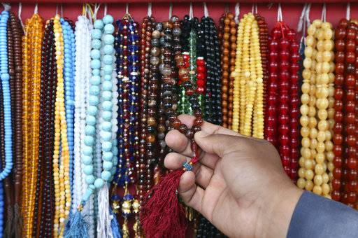 A customer purchases prayer beads ahead of the upcoming holy fasting month of Ramadan in Kabul, Afghanistan, Wednesday, May 16, 2018. Muslims across the world are observing the holy fasting month of Ramadan, when they refrain from eating, drinking and smoking from dawn to dusk.