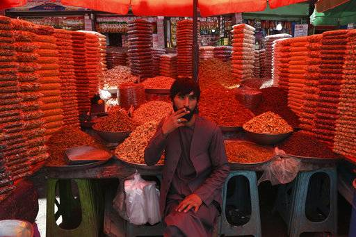 An Afghan dry fruits vendor waits for customers a market ahead of the upcoming holy fasting month of Ramadan in Kabul, Afghanistan, Wednesday, May 16, 2018. Muslims across the world are observing the holy fasting month of Ramadan, when they refrain from eating, drinking and smoking from dawn to dusk.