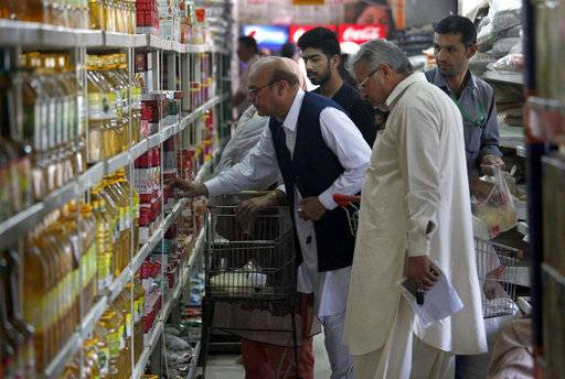 People browse specially-priced foodstuff from a government-run supermarket for the upcoming Muslim month of Ramadan, in Islamabad, Pakistan, Wednesday, May 16, 2018. Muslims across the world will be observing the holy fasting month of Ramadan, when they refrain from eating, drinking and smoking from dawn to dusk.