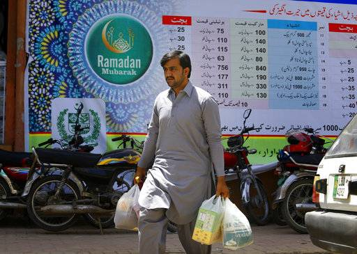 A man leaves after buying specially-priced foodstuff from a government-run supermarket for the upcoming Muslim month of Ramadan, in Islamabad, Pakistan, Wednesday, May 16, 2018. Muslims across the world will be observing the holy fasting month of Ramadan, when they refrain from eating, drinking and smoking from dawn to dusk.