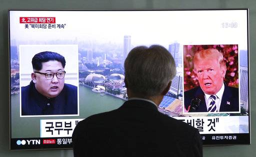A man watches a TV screen showing file footage of U.S. President Donald Trump, right, and North Korean leader Kim Jong Un during a news program at the Seoul Railway Station in Seoul, South Korea, Wednesday, May 16, 2018. North Korea's breaking off a high-level meeting with South Korea and threatening to scrap next month's historic summit with President Trump over allied military drills is seen as a move by Kim to gain leverage and establish that he's entering the crucial nuclear negotiations from a position of strength. Washington and Seoul, which have no intentions to overpay for whatever Kim brings to the table, say international sanctions forced Kim into talks after a flurry of weapons tests.