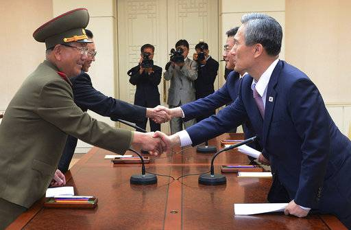 FILE -In this Aug. 25, 2015 file photo provided by the South Korean Unification Ministry, South Korean presidential security adviser Kim Kwan-jin, right, and Unification Minister Hong Yong-pyo, second right, shake hands with Hwang Pyong So, left, North Korea' top political officer for the Korean People's Army, and Kim Yang Gon, a senior North Korean official responsible for South Korean affairs, during after their meeting at the border village of Panmunjom in Paju, South Korea. Pyongyang's surprise declaration to break off a high-level meeting with Seoul and threat to scrap next month's historic summit with Washington provides a fresh reminder of failures and false starts that shattered previous diplomatic attempts. (The South Korean Unification Ministry via AP, File)