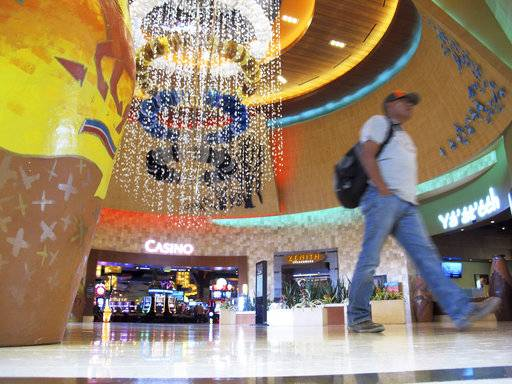 A man walks through the lobby of the Navajo Nation's Twin Arrows Casino, east of Flagstaff, Ariz., Tuesday, May 15, 2018. American Indian tribes are welcoming the opportunity to add sports betting to potentially hundreds of casinos across the country after the U.S. Supreme Court cleared the way for states to legalize it.