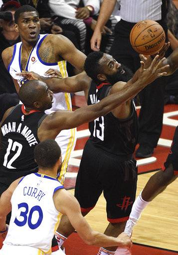 Houston Rockets guard James Harden, right, and forward Luc Mbah a Moute vie for a loose ball during the first half of Game 2 of the NBA basketball playoffs Western Conference finals against the Golden State Warriors, Wednesday, May 16, 2018, in Houston.