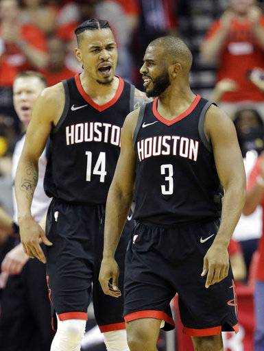 Houston Rockets guard Chris Paul (3) celebrates a score with teammate Gerald Green (14) during the first half in Game 2 of the NBA basketball Western Conference Finals against the Golden State Warriors, Wednesday, May 16, 2018, in Houston.