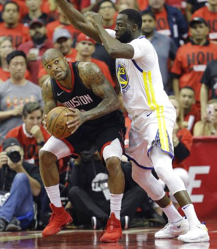Houston Rockets forward P.J. Tucker, left, is pressured by Golden State Warriors forward Draymond Green (23) during the first half in Game 2 of the NBA basketball Western Conference Finals, Wednesday, May 16, 2018, in Houston.