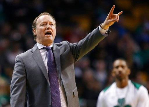 FILE - In this April 8, 2018, file photo, Atlanta Hawks coach Mike Budenholzer signals during the third quarter of the team's NBA basketball game against the Boston Celtics in Boston. A person familiar with the search tells The Associated Press that the Milwaukee Bucks have reached agreement with Budenholzer to become the team's next coach. The 2015 NBA Coach of the Year will replace Joe Prunty, the former assistant who went 21-16 in the regular season after replacing the fired Jason Kidd in late January.