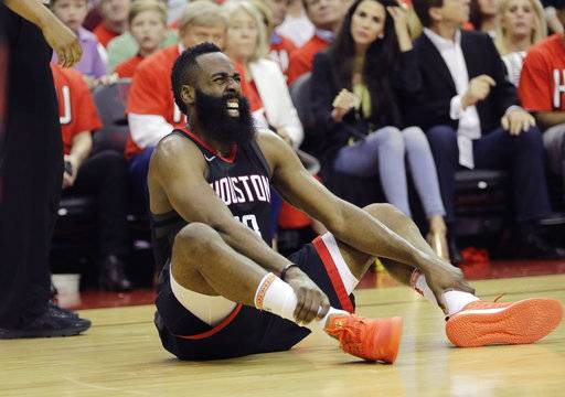 Houston Rockets guard James Harden reacts after he was injured during the first half of Game 1 of the NBA basketball Western Conference Finals against the Golden State Warriors, Monday, May 14, 2018, in Houston.