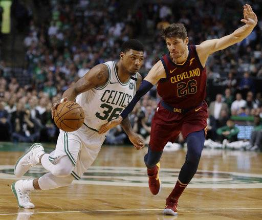 Boston Celtics guard Marcus Smart, left, drives against Cleveland Cavaliers guard Kyle Korver during the second half in Game 2 of the NBA basketball Eastern Conference finals, Tuesday, May 15, 2018, in Boston.