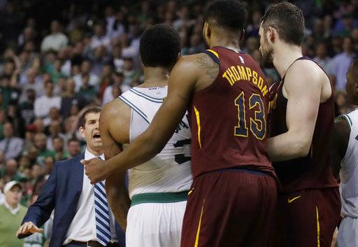 Boston Celtics coach Brad Stevens, left, races to separate guard Marcus Smart, second from left, from Cleveland Cavaliers guard JR Smith, hidden from view behind Cavaliers center Tristan Thompson (13), during the second half in Game 2 of the NBA basketball Eastern Conference finals, Tuesday, May 15, 2018, in Boston. Smith was called for a flagrant foul for shoving Celtics forward Al Horford while he was in the air shooting the ball.