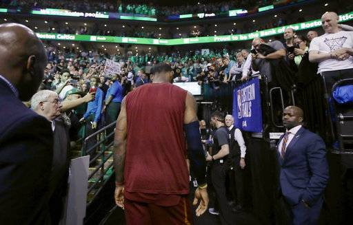 Cleveland Cavaliers forward LeBron James heads off the court after the team's 107-94 loss to the Boston Celtics in Game 2 of the NBA basketball Eastern Conference finals Tuesday, May 15, 2018, in Boston.