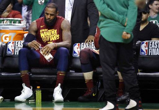 Cleveland Cavaliers forward LeBron James sits on the bench during a timeout in the second half in Game 2 of the team's NBA basketball Eastern Conference finals against the Boston Celtics, Tuesday, May 15, 2018, in Boston.