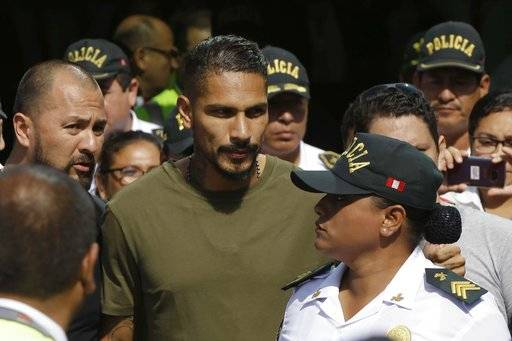 "Peru captain Paolo Guerrero arrives in Lima, Peru, Tuesday, May 15, 2018. The global footballers' union wants FIFA's help to review anti-doping rules after Guerrero was banned from the World Cup for a positive test for cocaine caused by contaminated tea. FIFPro says a 14-month ban barring the 34-year-old Guerrero from his World Cup debut is ""unfair and disproportionate."""