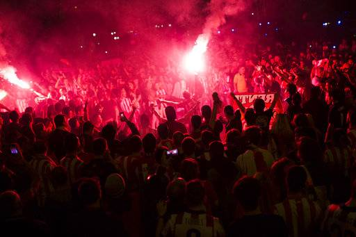 Atletico Madrid supporters light flares as they celebrate their team's Europa League tittle in Madrid, early Thursday, May 17, 2018. Atletico defeated Marseille 3-0 in the final and clinches its third Europa League title.