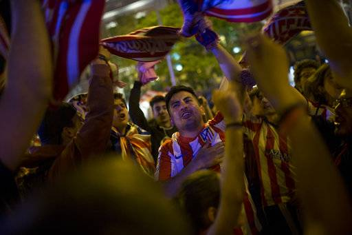 Atletico Madrid supporters celebrate their team's Europa League title in Madrid, Wednesday, May 16, 2018. Atletico defeated Marseille 3-0 in the final and clinches its third Europa League title.