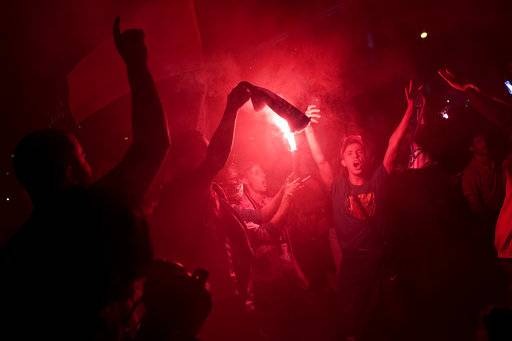 Atletico Madrid supporters light flares as they celebrate their team's Europa League title in Madrid, Wednesday, May 16, 2018. Atletico defeated Marseille 3-0 in the final and clinches its third Europa League title.