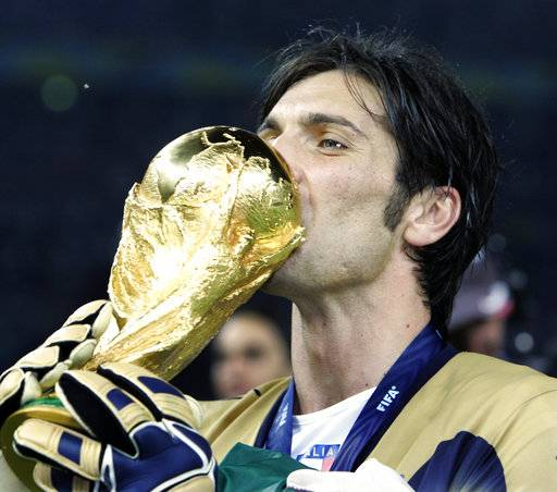 FILE - In this Sunday, July 9, 2006 filer, Italy goalkeeper Gianluigi Buffon kisses the World Cup trophy after the final of the soccer World Cup between Italy and France in the Olympic Stadium in Berlin, Sunday, July 9, 2006. Juventus captain Gianluigi Buffon has announced he is leaving the Italian club but the goalkeeper could continue playing elsewhere. Buffon, who is widely regarded as one of the best goalkeepers of all time, was expected to announce his retirement at a press conference at Allianz Stadium on Thursday, May 17, 2018.
