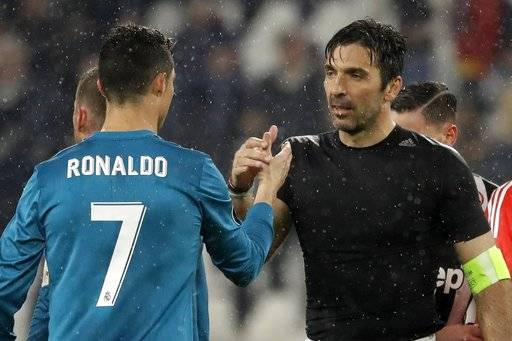 FILE - In this Tuesday, April 3, 2018 filer, Juventus goalkeeper Gianluigi Buffon, right, shakes hands with Real Madrid's Cristiano Ronaldo after the Champions League, round of 8, first-leg soccer match between Juventus and Real Madrid at the Allianz stadium in Turin, Italy. Juventus captain Gianluigi Buffon has announced he is leaving the Italian club but the goalkeeper could continue playing elsewhere. Buffon, who is widely regarded as one of the best goalkeepers of all time, was expected to announce his retirement at a press conference at Allianz Stadium on Thursday, May 17, 2018.